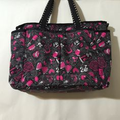 """Barbie Lesportsac Pattern Bag """"Ryan"""" Style This is the ultimate diaper bag for a fashionista baby girl ;) or fun work purse! I actually use this style as my work tote and have it in many different colors. This one was only used 2 times and is in like new condition. Includes a cross body strap (with printed silver hearts...so cute!). No matching changing pad.  I do have a changing pad I'm going to include from my black patent version.  Happy to answer questions!  Interior photos on another…"""