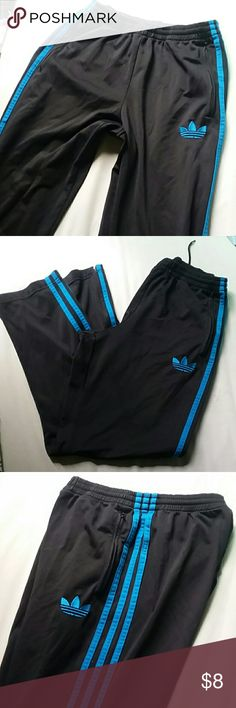 Adidas black & blue sweat pants S In excellent condition. Black with bright blue stripes and detail. Zipper pockets in front and zippers on the cuff. Fits a women's S/M adidas Pants Track Pants & Joggers