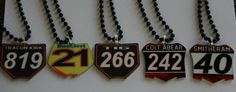 We recreate your dirt bike front number plate onto a metal pendant that you can wear as either a necklace or  Black and white 40 style