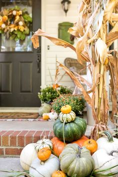 We are officially in the fall season! Let me show you festive ways to decorate your porch using traditional and non-traditional colors. #fallporchdecor #falldecor #fallinspiration #cutefallporch White Pumpkins, Painted Pumpkins, Porch Decorating, Decorating Tips, Traditional Porch, Pumpkin Topiary, Jar Chandelier, Magnolia Wreath, Thanksgiving Table Settings