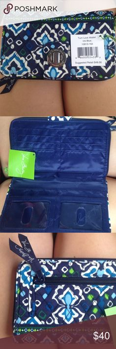 """NWT Vera Bradley Turn Lock Wallet Ink Blue New with tags! Vera Bradley """"Ink Blue"""" wallet. Perfect condition. Two I.D. card holders. 12 card holders, a place for cash, and coins. Perfect condition. Bought this for $49. Vera Bradley Bags Wallets"""