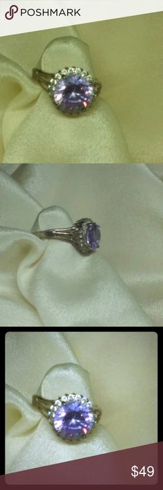 Amethyst Sterling Halo Ring Brilliant purple amethyst surrounded by cz's set in soil 925 sterling silver. Its in very good condition with no missing stones. Size 6. Jewelry Rings
