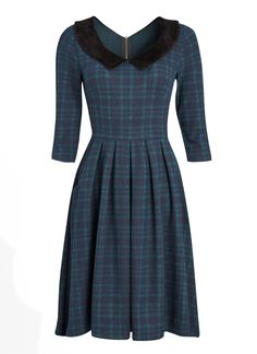 The Clara check dress is perfect for daytime in a wintry green and navy tartan with a black velvet peter pan collar and a flattering fit and flare shape.