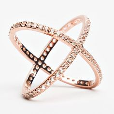Style #100 Sterling Silver Rhodium 18k Rose Gold, with Created White Sapphire Criss crossing bands of precious metal are decorated with brilliant pavé-set cryst