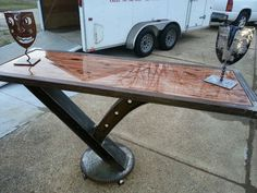 """I Beam Table. Designed for bar stools. The base is made with an Industrial sprocket, brass feet, tubular frame, and stained wood top! Designed and Fabrication by """"L.S. Designs""""  www.lorenzoscruggs.com"""