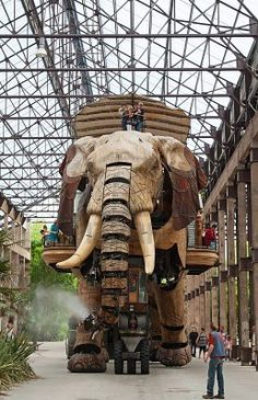 NANTES - AUGUST 09: The Great Elephant of Nantes on August 09, 2009 in Nantes, France. The gigantic mechanical animal, 12-metre high by 8-metre wide is main attraction of steampunk park