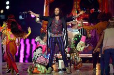LONDON, ENGLAND - AUGUST 12: Entertainer Russell Brand performs during the Closing Ceremony on Day 16 of the London 2012 Olympic Games at Olympic Stadium on August 12, 2012 in London, England. (Photo by Jeff J Mitchell/Getty Images)