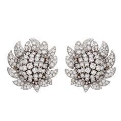 David Webb Large Diamond Flower Earclips   From a unique collection of vintage clip-on earrings at http://www.1stdibs.com/jewelry/earrings/clip-on-earrings/