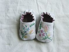 "Reversable baby shoes made from old linen by Melissa Wastrey. Pattern in her book ""Sweet and Simple"" which contains many crafted items for children using recycled fabrics."