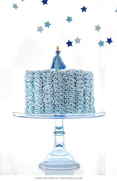 Learn how to make this Cinderella birthday cake with buttercream ruffles, a sprinkle of glittering princess stars and a Cinderella DecoSet® Cake Topper. By Carrie Sellman for TheCakeBlog.com.