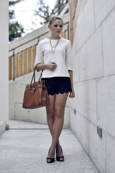 chic shorts with white top and brown bag