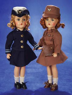 """Pair,American Composition Dolls in Original Military Uniforms by Alexander 14"""" (36 cm.) Each has composition socket head,blue sleep eyes,moh..."""