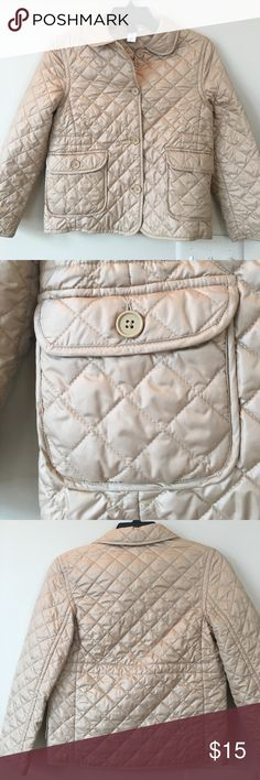 """Girls Quilted gap jacket Girls lightly worn Gap Quilted jacket size M (7/8). This lightweight Quilted jacket is perfect for Spring!  This gorgeous beige jacket has two front pockets .  The chest measures 15"""" across the chest and has a length of  19 1/2"""". Perfect condition! GAP Jackets & Coats"""