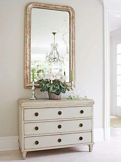 Get this look with our Maison Swedish 3 drawer chest and our Louis XVI gilded mirror.