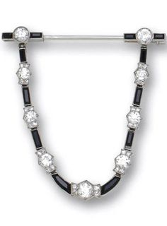 An art deco diamond and onyx jabot brooch, Cartier, French, circa 1925 designed a single swag alternating calibré-cut onyx, old-European and single-cut diamond sections; signed Cartier; no. 16262 (indistinct); with French assay mark; with signed fitted box; estimated total diamond weight: 2.60 carats; mounted in platinum (several onyx chipped)