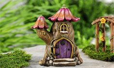 Invite gnomes, trolls, fairies, or wee ones of your choice to reside in this fantastical tree house. Fronted by a colorful, enchanted door and steps.  Size approx 6H x 4W