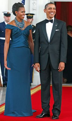 FLOTUS took her navy off-the-shoulder Marchesa creation to the next level with a Tom Binns statement necklace to greet the British prime minister David Cameron at the White House's 2012 dinner.