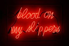 'Blood on my slippers' Neon, 2005 by artist Bill Rowe.