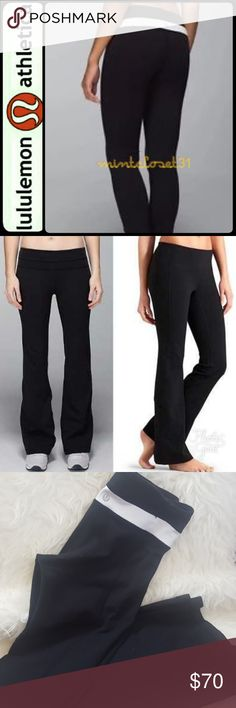 Lululemon Flare Yoga Pants Lululemon Athletica Signature Yoga Pants in Groove Flare Style! Features Reversible Style with Solid Black on One Side and White Stripe Waistband on Black when Reversed!   Regular length with approximately 30 inches inseam,  then pants length about 38 inches! Used in Good Condition! lululemon athletica Pants Boot Cut & Flare