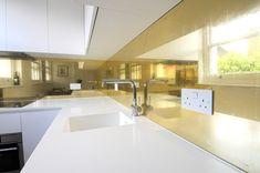 Gold églomisé kitchen splashback