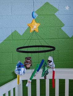 A mobile of brightly colored light sabers above her changing table would be awesome.