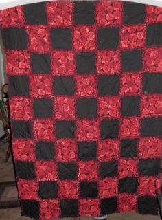 A personal favorite from my Etsy shop https://www.etsy.com/listing/289345615/beautiful-red-floral-and-black-rag-quilt