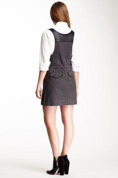 "Button Front A-Line Leather Combo Jumper in charcoal by Charlotte Ronson $215 - $65 at HauteLook. [Back] - Sleeveless - Front button closure - Contrast leather trim - 3 front pockets - 2 back pockets - Topstitching - Approx. 32"" length Fit: this style fits true to size. Model's stats for sizing: - Height: 5'9.5"" - Bust: 34"" - Waist: 24"" - Hips: 34.5"" Model is wearing size 4. Dry clean. Self: 98% cotton, 2% spandex. Combo: 100% sheep leather."