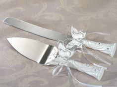 Hey, I found this really awesome Etsy listing at https://www.etsy.com/listing/214319109/butterfly-cake-knife-serving-set