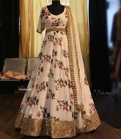 White floral gown with gold border. Indian Fashion Dresses, Indian Bridal Outfits, Indian Gowns Dresses, Indian Party Wear, Dress Indian Style, Indian Designer Outfits, Pakistani Dresses, Long Dress Design, Stylish Dress Designs
