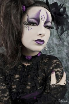 While not scary........this makeup would be perfect for a Halloween Party.....get your make-up at: HalloweenMarketplace.com