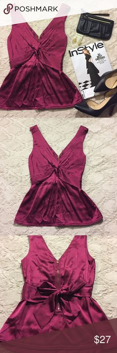 🎄SALE🎄BCBGMaxAzria Silk Tank Top EUC! Like new tank top made of 93% silk and 7% spandex. In a flattering Peplum style with a bow you tie in the back. Dramatic v-neck to accentuate the waist and chest. Super sexy deep red color-- perfect for the holidays! Golden zipper in the back. Bundle and save! 💕🎄🙌🏼😊 BCBGMaxAzria Tops Tank Tops