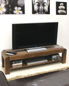 A stunning dark wood contemporary treat of a piece of furniture, this TV unit includes a fixed shelf to provide elegant storage for your television-related equipment such as DVD player, Sky/Freeview box, etc. It is designed to house large plasma/LCD/LED television sets up to 72″ in size, and makes a beautiful addition to any home. Naturally, it also coordinates wonderfully with the remaining pieces in our solid walnut living furniture collection. Only £269.
