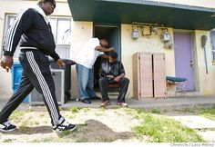 To make extra money John Smith cuts the hair of Leon Charles outside his apartment, April 5, 2007 in the Sunnydale Projects in Visitation Valley, in San Francisco. (Lacy Atkins San Francisco Chronicle) Photo: Lacy Atkins