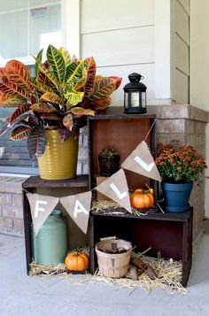 Create a fall crate display to show off your fall decor on your front porch.