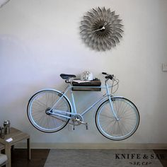 Knife & Saw Bike Shelf at DWR -- may do something like this to keep bike in condo since bike racks have not appeared in garage