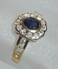 Ring of 14 kt/585 gold 0.52 ct diamonds + 0.50 ct sapphire small ring size 51 / 16.2 mm