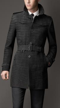 Burberry Mid-Length Alligator Leather Trench Coat on shopstyle.com | Statement trench coat in exotic alligator leather Set-in sleeves, back pleat detail Heritage features reference the original Burberry trench coat Features & Care 88cm, 34.6in long 100% alligator leather Specialist clean Made in Italy