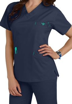 FLAWLESS FLEX AND FLAIR  Details matter in this breezy V-neck scrub top that stretches with you all through your shift. Pockets within pockets keep the tools of your trade safely tucked away, and a badge loop means you don't have to use flimsy metal clips to anchor your I.D. Like other Med Couture scrub tops, this EZ Flex Classic (in New Navy/Spearmint)  is sure to be a favorite.