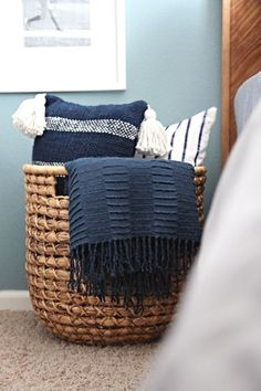 House Beautiful Magazine saved to OrganizingA wicker catch-all adds a rustic touch to a bedroom and creates an instant way to store pillows with ease. If you get one that's big enough, you can add throw blankets to the basket as well. Click through for more on this and other bedroom throw pillow storage ideas. #homedesignideas #bedroomdecor #bedrooms
