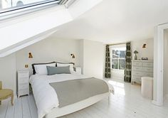 white floorboards, cream walls, comfy bed, loft conversion with dormer