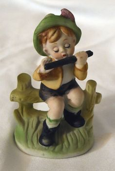 DAVAR Figurine of Boy Sitting on Fence Playing Flute - Vintage