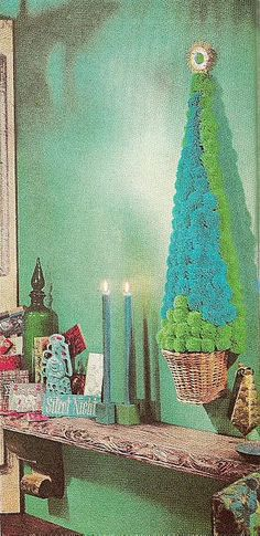 I am SO making a pom-pom Christmas tree! (My 'planter' will be worthy of this level of awesomeness however)