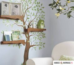 Love the shelves layered on the tree wall sticker.