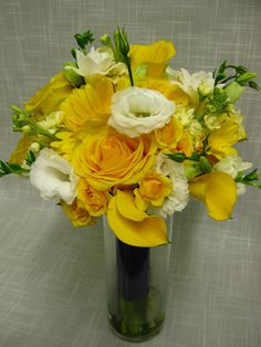 Yellow and white Bridal bouquet of gerbera daisies, roses, spray roses, mini calla lilies, stock, freesia and lisianthus.