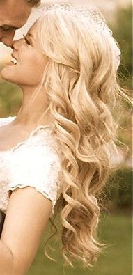 A little paler than the color I want, but the way the curls are pinned away from the face is lovely.