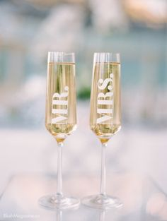 Stylized Wedding Shoot at Fairmont Banff Springs. Toast, Toasting glasses, Mr. & Mrs., Toasting Flutes, Champagne