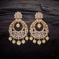 Beautifully Designed CZ Zircon Hanging earrings studded with synthetic stones and pearl drops, with Rose gold Polish. Indian Jewelry Earrings, Bridal Jewelry, Chand Bali Earrings Gold, Antique Jewellery Designs, Fancy Jewellery, Gold Jewelry Simple, Cute Jewelry, Jewelry Art, Stone Earrings