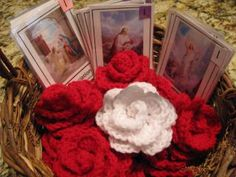 Teach the rosary using crocheted roses -- Love this idea for my 2 year old, just need to find a place to buy the roses (no time to learn!)