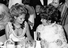 11th September 1967: Film actress Elizabeth Taylor with Italian actress Claudia Cardinale at a charity ball in Venice during the Film Festival. Photo: Keystone Features, Getty Images / Hulton Archive