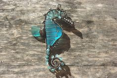 Turquoise Seahorse wire wrapped seaglass pendant.